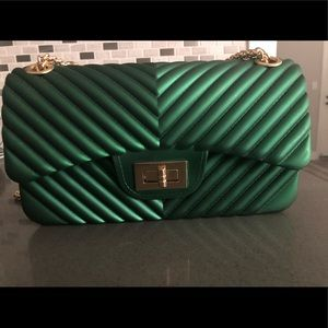 Green crossbody bag with gold chain